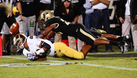 Corey Robinson dives for the ball as Purdue's Frankie Williams defends. Purdue was called for pass interference on the play.