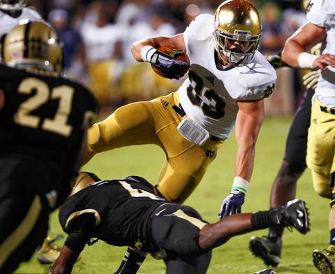 Notre Dame's Cam McDaniel runs the ball against Purdue.