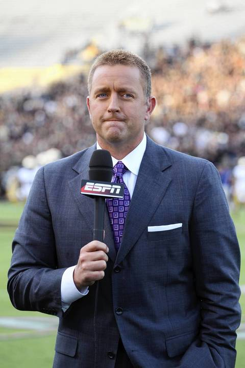 ABC announcer Kirk Herbstreit talks on the sidelines.