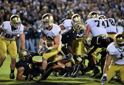 Running back Cam McDaniel runs into the end zone for a touchdown as Purdue's Greg Latta defends in the third quarter.