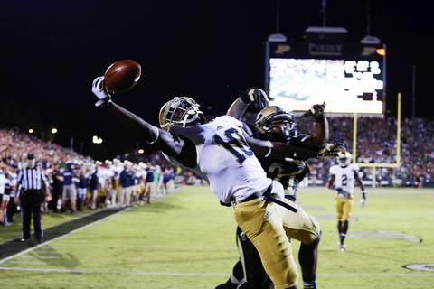 Wide receiver DaVaris Daniels tries to make a one handed catch in the end zone against Purdue's Ricardo Allen.