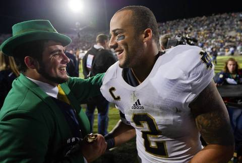 Bennett Jackson celebrates with the Notre Dame Leprechaun.