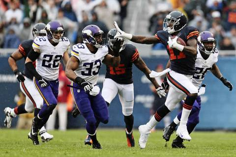 Chicago Bears' wide receiver Alshon Jeffery (17) sticks his arm out to block Minnesota Vikings' strong safety Jamarca Sanford (33).