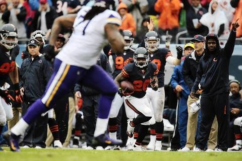 Chicago Bears' cornerback Tim Jennings (26) runs the ball during the first half of an NFL football game between the Chicago Bears and the Minnesota Vikings.
