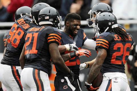 Chicago Bears' wide receiver Devin Hester (23), center, celebrates with Chicago Bears' cornerback Tim Jennings (26) after Jennings scored a touchdown against the Minnesota Vikings.