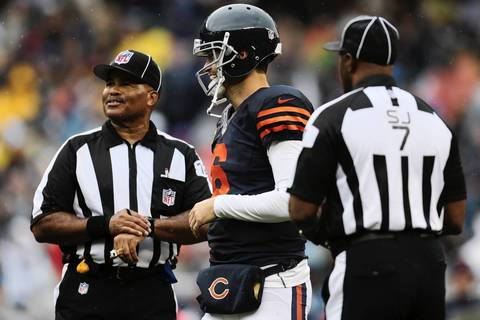 Chicago Bears' quarterback Jay Cutler (6) jokes with the officials during the first half.
