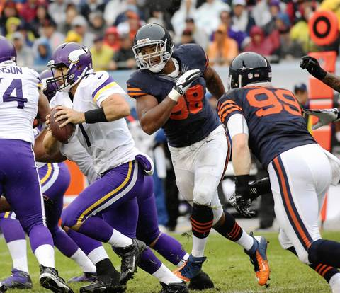 Corey Wooten of the Bears (98) chases after Vikings quarterback Christian Ponder in the first quarter at Soldier Field.