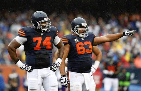 Chicago Bears tackle Jermon Bushrod (74) is called on a penalty as Chicago Bears center Roberto Garza (63) points against the Minnesota Vikings in the first quarter at Soldier Field.
