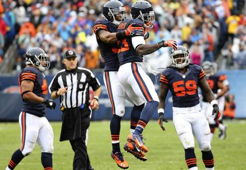 Devin Hester of the Bears celebrates an 80-yard punt return in the second quarter against the Vikings at Soldier Field.
