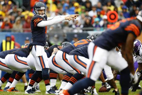 Chicago Bears quarterback Jay Cutler (6) signals against the Minnesota Vikings in the first quarter at Soldier Field.