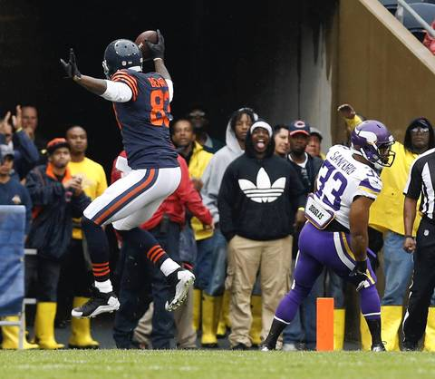 Chicago Bears tight end Martellus Bennett (83) celebrates a touch down reception as Minnesota Vikings strong safety Jamarca Sanford (33) looks on in the first quarter at Soldier Field.