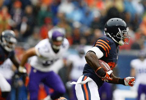 Chicago Bears Devin Hester (23) returns a kickoff for 76 yards against the Minnesota Vikings in the first quarter at Soldier Field.