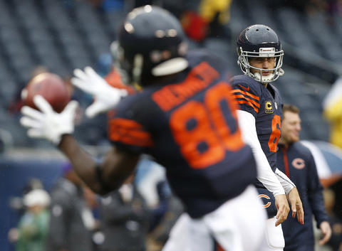 Chicago Bears quarterback Jay Cutler (6) throws to Chicago Bears wide receiver Earl Bennett (80) during warm ups prior to facing the Minnesota Vikings at Soldier Field on Sunday.