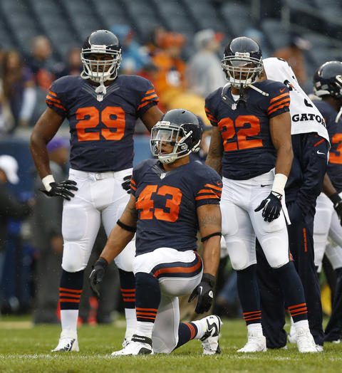 Chicago Bears fullback Tony Fiammetta (43), Chicago Bears running back Michael Bush (29) and Chicago Bears running back Matt Forte (22) during warm-ups prior to facing the Minnesota Vikings at Soldier Field on Sunday.