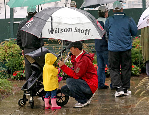 Jeff Soukup of Lake Forest, with his daughter Liesl , 2 waiting out the rain delay at the last round BMW Championship at Conway Farms Golf Club, in Lake Forest, Ill., on Sunday.