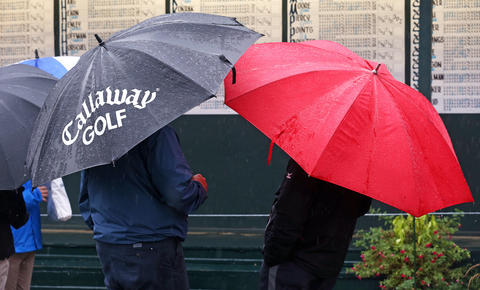 Fans, waiting out the rain delay at the last round BMW Championship at Conway Farms Golf Club, in Lake Forest, Ill., on Sunday.