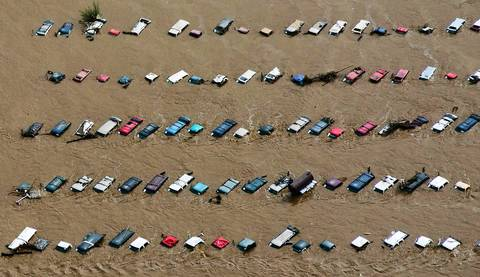 Vehicles submerged in flood waters along the Sough Platte River near Greenley, Colo.