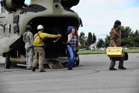 Colorado Army National Guardsmen evacuate residents stranded in flood zones.