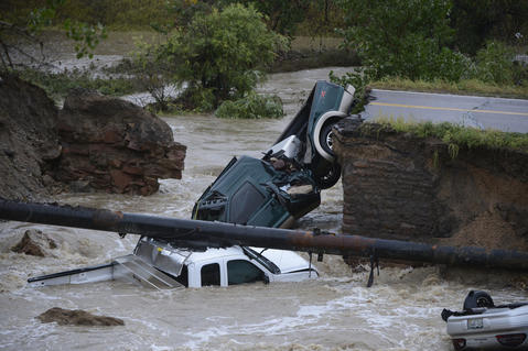 Three vehicles crashed into a creek after the road washed out from beneath them near Dillon Rd. and 287 in Broomfield Colorado, September 12, 2013 in heavy flooding.