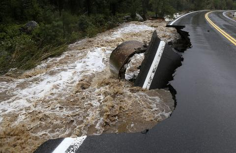 A section of Highway 72 is missing after a flash flood tore through Coal Creek near Golden, Colorado September 12, 2013.