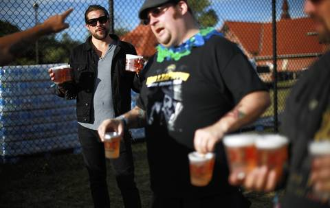 Greg Rieck, left, and his friends are turned away from entering Riot Fest because they were holding too many beers.