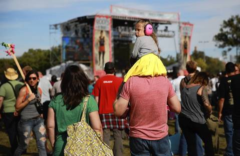 Lucy Lippert, 4, wears ear protectors during a performance by Dinosaur Jr.