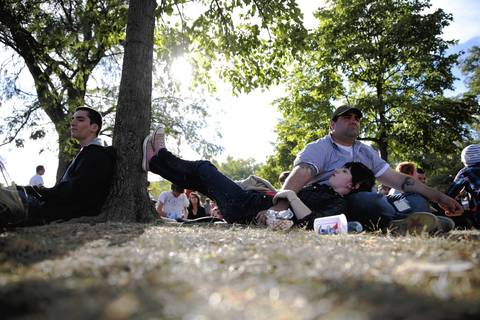 Alison Wahrburg of Carle Place, New York, rests her feet on a tree trunk and her head on husband Eric's lap.