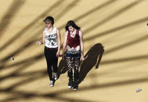 Two women walk through the grounds.