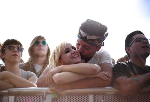 Yani Lord kisses Mable Palombo during a performance by Dinosaur Jr.
