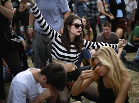 A concertgoer stretches while waiting for the music to begin.