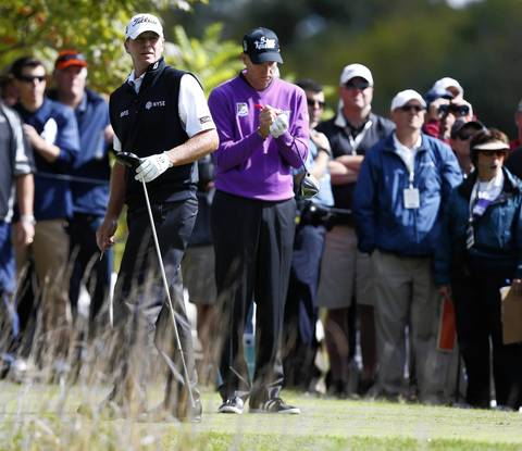 Steve Stricker, left, watches his ball on the 8th tee as Jim Furyk prepares to hit.