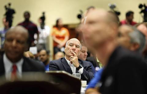 Candidate for Illinois Governor Bill Daley, center, listens to speakers during the 2013 Annual Governor's Day Brunch at the Crowne Plaza Hotel in Springfield. State Democratic leaders gathered for the breakfast before heading the Illinois State Fair.