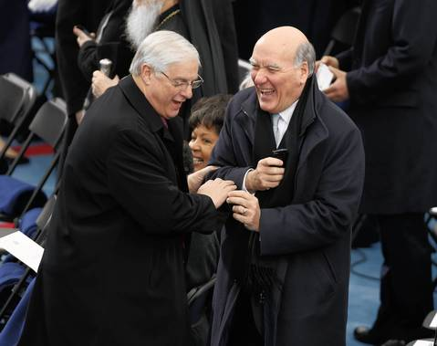 Bill Daley shares a laugh with other dignitaries before the ceremonial inauguration of President Barack Obama at the U.S. Capitol.