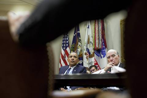 President Barack Obama and Chief of Staff Bill Daley listen during a meeting with senior advisers in the Roosevelt Room of the White House.