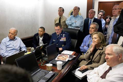 President Barack Obama and Vice President Joe Biden, left, along with with members of the national security team, including Bill Daley, center in blue suit, receive an update on the mission against Osama bin Laden in the Situation Room of the White House.