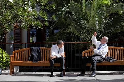 President Barack Obama talks with Chief of Staff Bill Daley before the APEC CEO business summit in Honolulu, Hawaii.