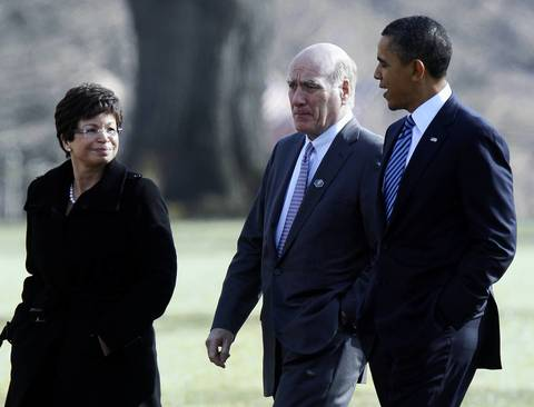 U.S. President Barack Obama walks with senior adviser Valerie Jarrett, left, and White House Chief of Staff Bill Daley, center, from the White House before giving a speech at the U.S. Chamber of Commerce Building in Washington.