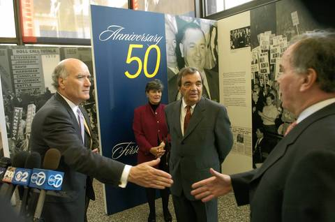 "Bill Daley, left, greets his brother Mayor Richard Daley and are joined by sister Mary Carol rear, and John before an exhibit tour in Chicago. The family got together to tour the ""Richard J. Daley: the Mayoral Career"" photo exhibit at the Daley Center."