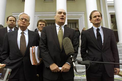Vice President Al Gore's legal strategists, from left to right, attorney Dexter Douglass, campaign chairman Bill Daley and attorney David Boies, speak with reporters on the steps of the Florida Supreme Court. The state high court heard arguments from attorneys representing both presidential candidates concerning the state's November 7 presidential election.