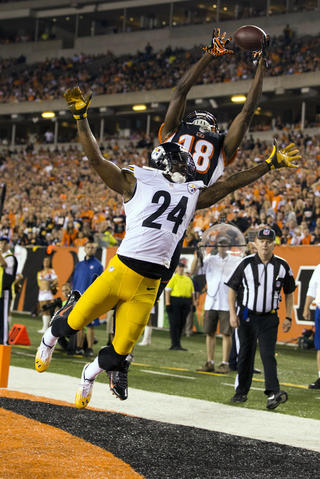 Sep 16, 2013; Cincinnati, OH, USA; Cincinnati Bengals wide receiver A.J. Green (18) tries to make a touchdown catch as Pittsburgh Steelers cornerback Ike Taylor (24) defends at Paul Brown Stadium. Cincinnati won the game 20-10.