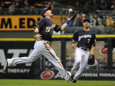 Sep 16, 2013; Milwaukee, WI, USA; Milwaukee Brewers second baseman Scooter Gennett can't catch a ball hit by Chicago Cubs catcher Welington Castillo (not pictured) that was ruled a double in the fifth inning at Miller Park. Mandatory Credit: