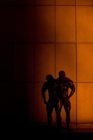 In a photo taken on September 15, 2013, a professional bodybuilder practices his moves backstage before competing in a bodybuilding contest in Zhengzhou, Henan province. More than 20 professionals -- including a dozen from China -- were competing in the Bodybuilding Grand Prix in the central Chinese city for a top prize worth 80,000 yuan (13,000 USD). They were joined by scores of amateurs from across the country, in what event organisers said was a sign of the increasing popularity of muscle building in China. Bodybuilding has at least a century of history in China, but fell out of favor following the Communist revolution in 1949, when competitions were sometimes banned and the sport condemned as western and bourgeois. But it has since enjoyed a resurgence and competitors say the growing number of competitions are boosting the ranks of local professionals.