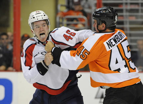 Sep 16, 2013; Philadelphia, PA, USA; Washington Capitals center Michael Latta (46) fights with Philadelphia Flyers center Kris Newbury (45) during the third period of preseason game at the Wells Fargo Center. The Capitals won 4-3 in a shootout over the Flyers.