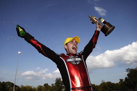 Sep 15, 2013; Charlotte, NC, USA; NHRA pro stock motorcycle rider Andrew Hines celebrates after winning the Carolina Nationals at zMax Dragway.
