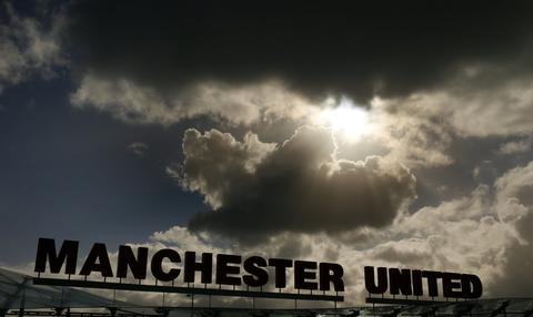 Rain clouds gather above Manchester United's Carrington training complex in Manchester September 16, 2013. United are set to play German side Bayer Leverkusen in the Champions League on Tuesday.