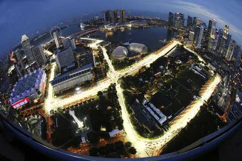 The Marina Bay street circuit is illuminated at dusk in Singapore September 17, 2013. The Singapore Formula One Grand Prix night race will take place on September 22, 2013. Picture taken with a fish-eye lens.