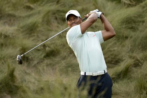 Jun 15, 2013; Ardmore, PA, USA; Tiger Woods tees off on the 18th hole during the third round of the 113th U.S. Open golf tournament at Merion Golf Club.