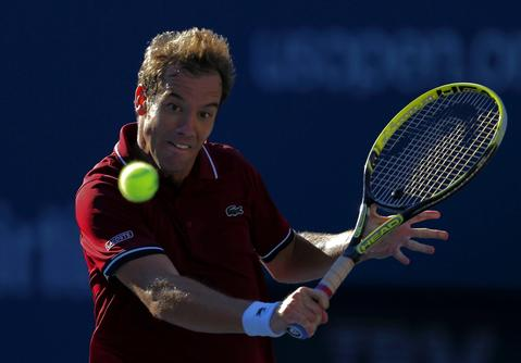 Richard Gasquet of France hits a return to David Ferrer of Spain at the U.S. Open tennis championships in New York September 4, 2013.