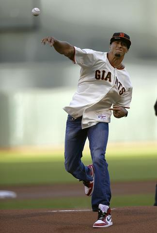 SAN FRANCISCO, CA - JUNE 21: Quarterback Colin Kaepernick of the San Francisco 49ers throws out the ceremonial first pitch before a Major League Baseball game between the Miami Marlins and San Francisco Giants at AT&T Park on June 21, 2013 in San Francisco, California.