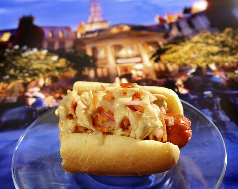 A 'Kimchi Dog' with Spicy Mustard Sauce from the Korea kiosk, featured in the upcoming 2013 edition of the Epcot International Food & Wine Festival, which runs Sept. 27 through November 11. Photographed Friday, August 23, 2013, in an exclusive Orlando Sentinel behind-the-scenes preview. (Joe Burbank/Orlando Sentinel) B583075881Z.1